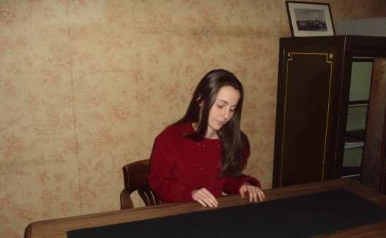 Julia Belanoff at the Anne Frank desk