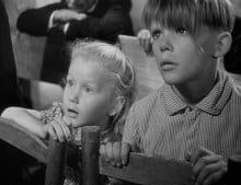 Georges Poujouly and Brigitte Fossey as Paulette and her protector Michel
