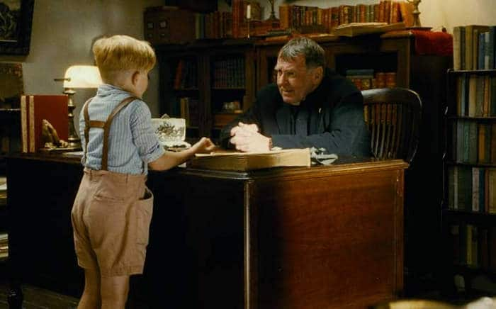 The Little Boy receiving the list from Fr. Oliver (Tom Wilkinson)