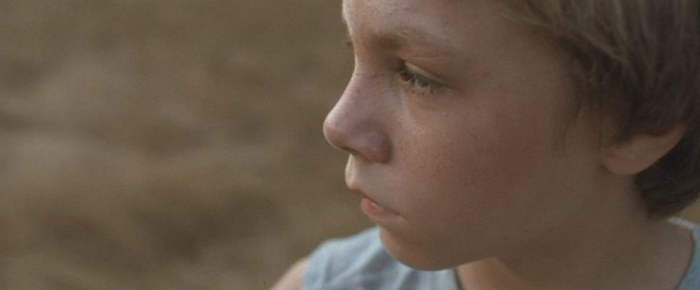 Close-up of Daniel Blanchard as The Boy.
